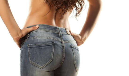 Picture of a woman with her back to the camera and happy with her perfect Brazilian butt lift procedure she had at Top Plastic Surgeons in beautiful San Jose, Costa Rica.  The woman has both hands on her hips indicating her happiness with the Brazilian butt lift.